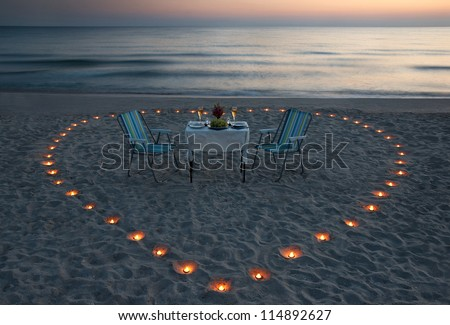 romantic dinner on the sea beach with candle heart in Maldives