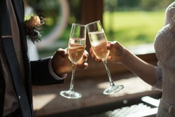 Romantic dinner or date with champagne glasses. Toast and clinking with alcoholic drinks. Celebration on wedding party. Marriage concept