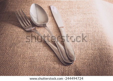 Romantic Dinner set concept with silverware on sackcloth textures