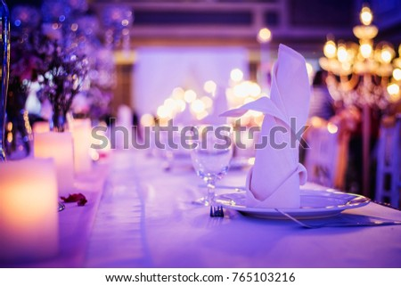 romantic dinner setup with candle light in a restaurant. Selective focus. Vintage color.