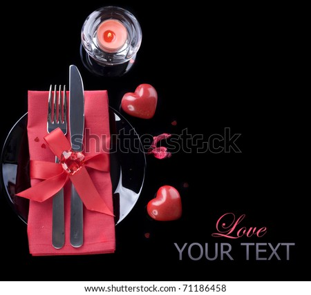 Romantic Dinner.Table place setting over black
