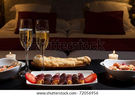 romantic dinner with champagne in the bedroom. Low key