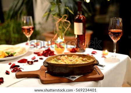 Romantic dinner with food and vine setting
