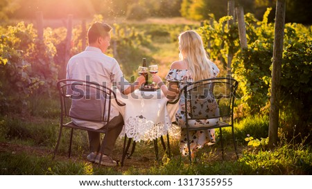 Romantic dinner with wine tasting in a place at sunset