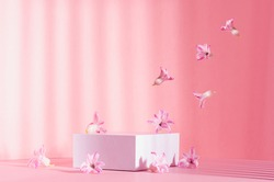 Romantic elegance three white square podiums with flow of levitate spring  flowers in sunlight with striped shadow on soft light pastel pink background. Fashion fresh showcase.