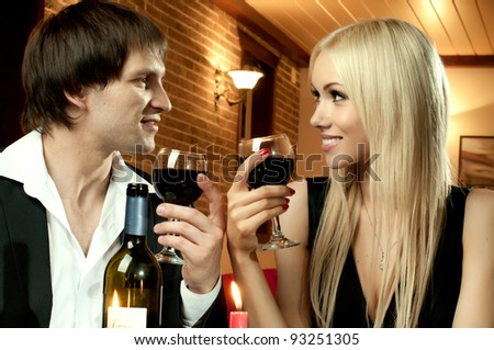 romantic evening date in hotel room, or supper in restaurant, happy couple with wine glass