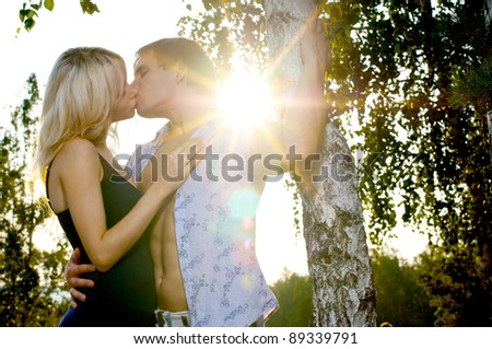 romantic evening date on nature, couple on beautiful sunset kiss