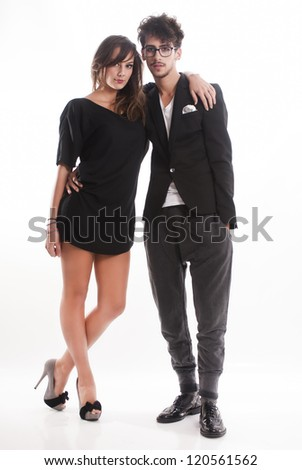 Romantic fashion young couple standing together on isolated white background