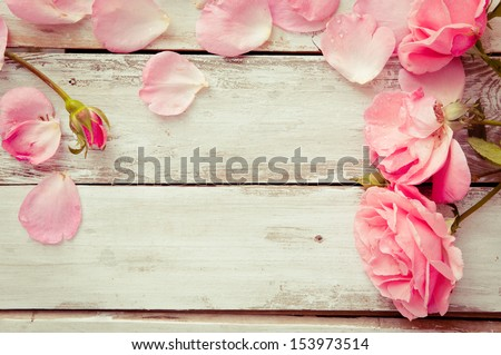 Romantic floral frame background/ Valentines day background/Pink roses on wooden background