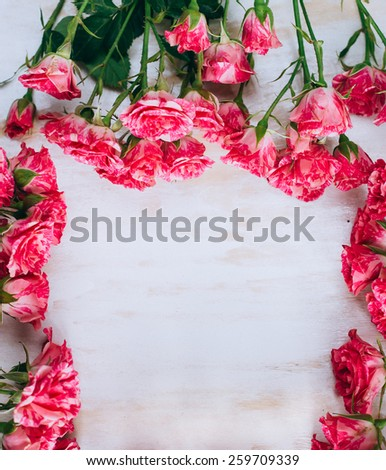 Romantic floral pink roses frame. Vintage background. Shabby-chic