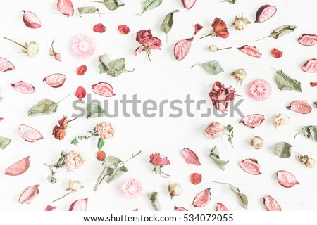 Romantic flowers. Frame made of dried flowers and leaves. Top view, flat lay. #534072055