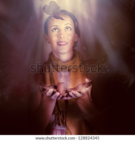 Romantic Girl Lost In A Cold Autumn Forest Looking Above To The Light Of Hope When Catching A Heart Shape Leaf In Fall From The Tree Of Love