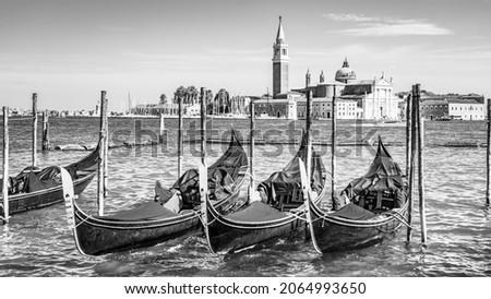 Romantic gondolas moored in Venice
