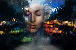 Romantic gothic sad dark hair open forehead pink make up face woman with closed eyes looks throw window on moistening rain fall in city with cars lights mirror effect on the glass in the night dark