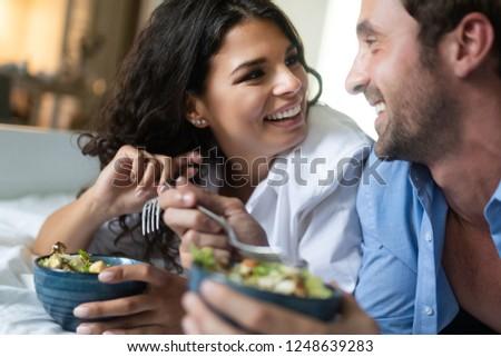 Romantic happy couple having breakfast in bed #1248639283
