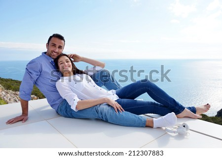 romantic happy young couple relax at modern home outdoors