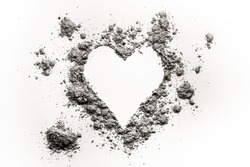 Romantic heart love symbol made in ash, dust or sand as burning bursting passion, painful emotion for valentines day concept, burnt feelings background