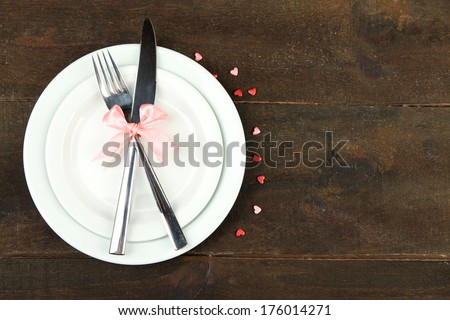 Romantic holiday table setting, on wooden background #176014271