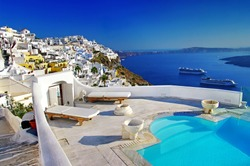 romantic holidays - luxury Santorini resorts. Gorgeous view from swimming pool. Greece travel