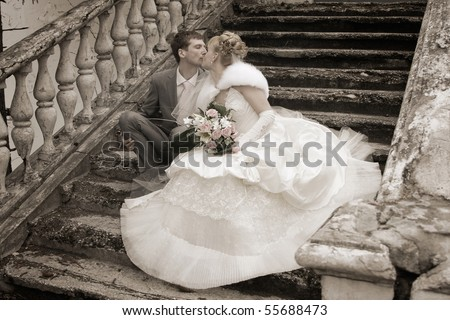 Romantic image of attractive couple. Smiling Newlywed Couple on Wedding Day. newly wed couple enjoy their time. Just married!
