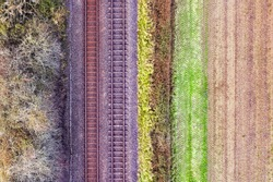 Romantic image of two railway tracks which consists of two parallel steel rails, anchored perpendicular to members called ties (sleepers) of concrete to maintain a consistent distance apart. Copyspace