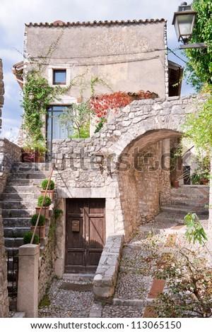 Romantic italian stone village, old stairway, door and arc.