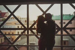 Romantic kiss of two lovers in the city / Young happy couple
