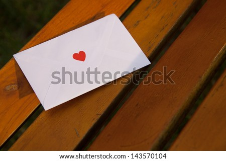 Romantic letter with a red heart on the envelope.