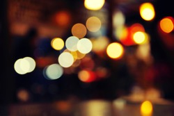 Romantic lights illumination in a cafe, abstract blurred background