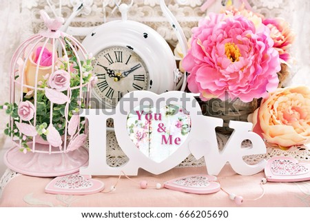 romantic love decoration in shabby chic style with letters,flowers,vintage clock and bird cages #666205690
