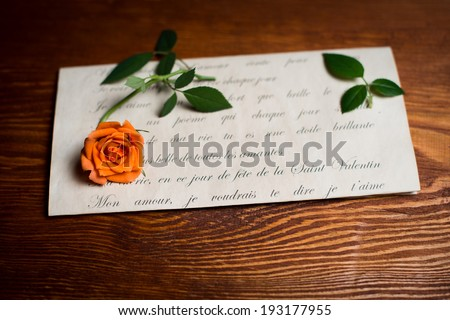 Romantic love letter and rose on wood. Valentine�s day background.