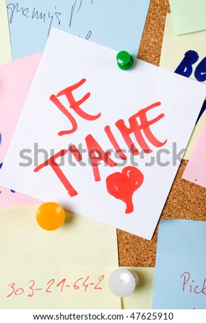 Romantic love note pinned on cork notice board