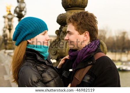 Romantic loving couple in Paris, looking in each others eyes