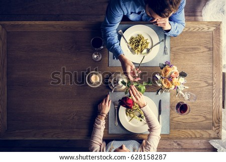 Romantic Man Giving a Rose to Woman on a Date #628158287