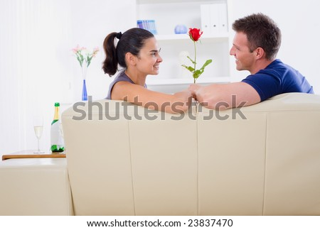 Romantic man giving red rose to woman - Valentine's Day.