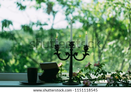 romantic mood. romantic mood with books and candle stick. romantic mood with no people. romantic mood concept. novel story.