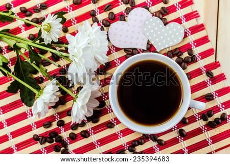 romantic mug of coffee and flower on striped napkin