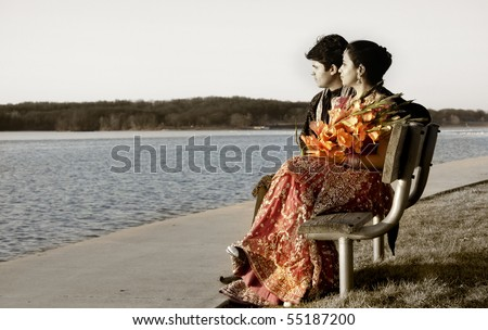 Romantic newly wed Indian couple by the lake