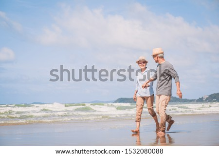 Romantic of retired couple holding hands and walking together each other talking happily. Love is everything.