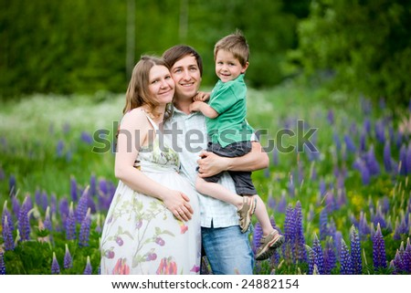 Romantic photo of young attractive expecting family