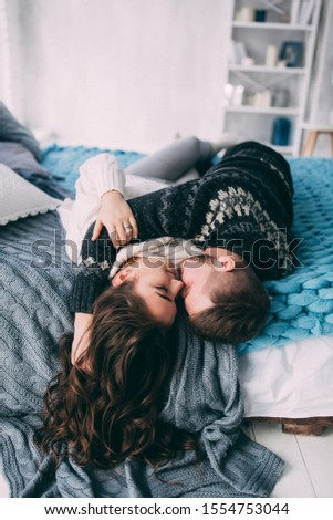 Romantic photo session of a young couple. Meeting a guy and a girl. The guy hugs his girlfriend.
