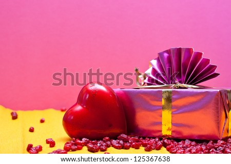 romantic pink background with heart and gift