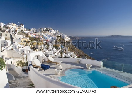 stock photo Romantic pool overlooking Santorini Greece