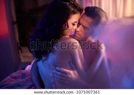 Romantic portrait of a sensual couple in a bedroom