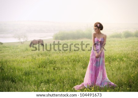 Romantic portrait of woman in foggy morning at the riverside