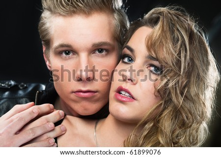 Romantic portrait of young blond handsome man and beautiful woman