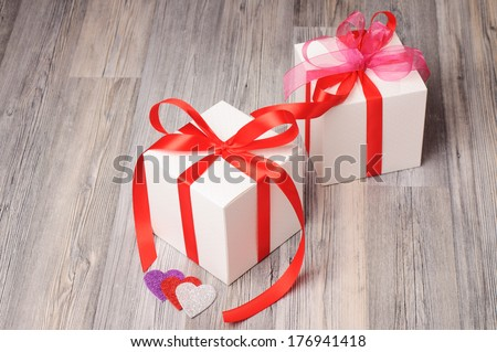 Romantic present boxes on a wooden surface