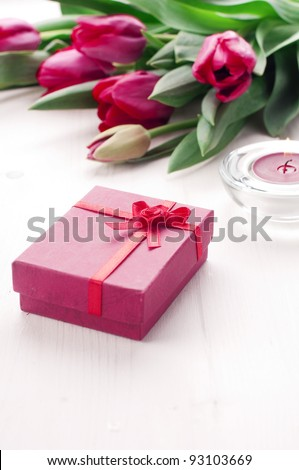 Romantic present with tulips and candle