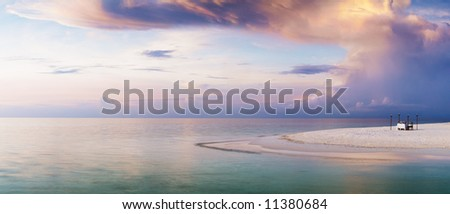 Stock Photo Romantic private dinner on the edge of the land. Pastel, soft colors.