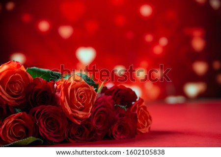 Romantic red roses on a red background with hearts, Valentine's day, love and romance, wedding background